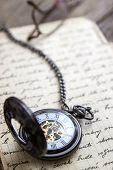 picture of vintage antique book  - Vintage pocket watch on old book closeup - JPG