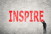 Asian businessman write text on wall, Inspire