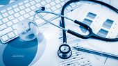 foto of endocrine  - Stethoscope with financial on the desk - JPG