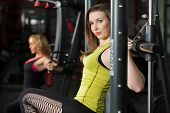 Girls Do Exercises For Arms And Shoulders In Gym