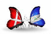 Two Butterflies With Flags On Wings As Symbol Of Relations Denmark And Nicaragua