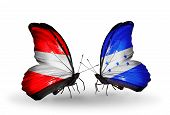 Two Butterflies With Flags On Wings As Symbol Of Relations Austria And Honduras
