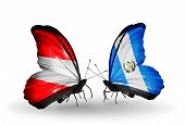 Two Butterflies With Flags On Wings As Symbol Of Relations Austria And Guatemala