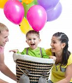 family playing with son in flight on a makeshift balloon