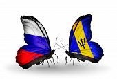 Two Butterflies With Flags On Wings As Symbol Of Relations Russia And Barbados