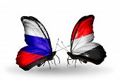 Two Butterflies With Flags On Wings As Symbol Of Relations Russia And Yemen