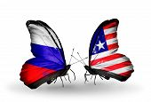 Two Butterflies With Flags On Wings As Symbol Of Relations Russia And Liberia