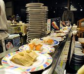 Sushi At A Conveyor Belt