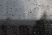 image of rainy weather  - Rain drops on the window glass - JPG