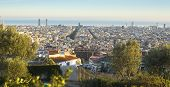 BARCELONA, SPAIN - DEC 25, 2014: Panorama of Barcelona from park Guel on a sunset. Barcelona is the capital city of Catalonia in Spain and country's 2nd largest city, with a population of 1.6 million.