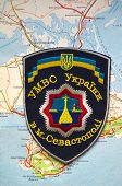 Illustrative editorial.Chevron of Ukrainian Police in Sevastopol,Crimea. Former Ukraine.At present time Russia.With map of Black Sea .At January 10,2015 in Kiev, Ukraine