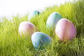 Many Decorative Easter Eggs On Sunny Green Grass