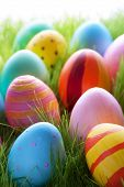 Many Colorful Easter Eggs On Sunny Green Grass