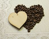 Two hearts made of wood and made of coffee beans