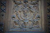 doorknob, old wooden door with carvings