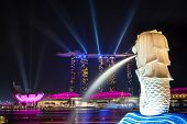 Colorful Laser Lights Up Singapore's Marina Bay Harbor At Night