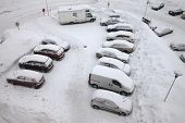 Parking cars covered by a lot of snow