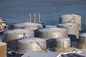 Big oil silos in a dock