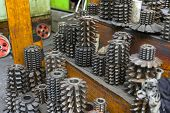 image of drill bit  - Industrial drill bits stacked up on the shelf - JPG