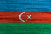 Azerbaijan flag painted on wood .