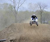 Racer Rides An Atv Down A Dirt Hill