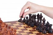 Female Hand Holding A Pawn On The Chessboard