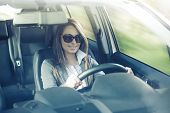 Attractive Woman With Sunglasses In Her Car