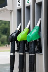 picture of petrol  - fuel pistols at Petrol station for different types of petrols - JPG
