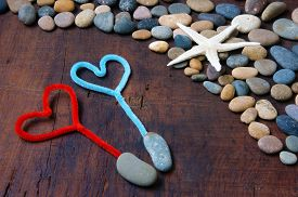 image of love hurts  - Colourful harmony Valentine background amazing style heart on pebble I love you message on stone wooden red color Valentine day on Feb 14 is the day for couple they give lovely gift for lover - JPG