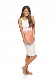 stock photo of flirty  - Full length flirty elegant woman in dress over white background - JPG