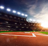 stock photo of arena  - Professional baseball grand arena in the sunlight - JPG