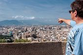 image of tourist-spot  - Tourist on the Alcazaba of Malaga is showing the old town with the Santa Iglesia Catedral Basilica de la Encarnaci - JPG