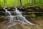 image of dam  - A beautiful little waterfall cascades over layers of rock strata near the dam at Indiana - JPG