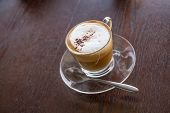 pic of latte  - Coffe Latte Cup On A Wood Table - JPG