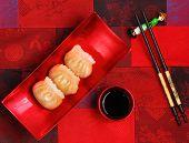 stock photo of siomai  - Vietnam style steamed shrimp dumplings served on a silk table cloth - JPG