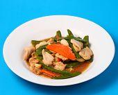 stock photo of stir fry  - chicken stir fry thai style on a blue background - JPG