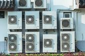 pic of air compressor  - White Air conditioning compressor near the wall - JPG