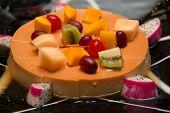 image of custard  - A Deliciuos caramel custard close shot with fresh fruit - JPG