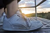 stock photo of early-man  - Shoes of a man jogging in the early morning - JPG