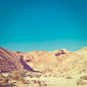stock photo of toned  - Rocky Hills of the Negev Desert in Israel Vintage Style Toned Picture - JPG