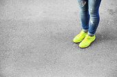 foto of street-walker  - Female feet over gray asphalt background - JPG
