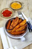 foto of pot roast  - Roasted potatoes with spices in a ceramic pot - JPG