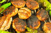 foto of meatball  - Fresh grilled meatballs and peppers closeup view