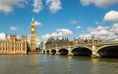 picture of westminster bridge  - Big Ben and the Houses of Parliament in London with Westminster Bridge and the River Thames in the foreground against a blue sky with fluffy white clouds - JPG