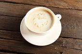 image of latte  - Cup of coffee latte art on wooden background - JPG