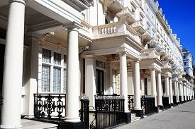 stock photo of kensington  - Expensive old fashioned typical Regency Georgian terraced town houses architecture in fashionable Kensington - JPG