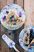 Постер, плакат: Slice of delicious cake with fresh blueberry on wooden backgroup Piece of blueberry cake piece of