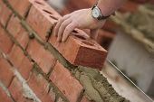 Bricklayer Building A Wall
