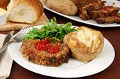 picture of baked potato  - A meatloaf dinner with salad and baked potato - JPG