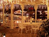Christmas Lights Decorated Gazebo Overlooking A Reflective Lake